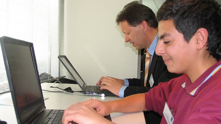 Andreas and Wael working on the computer