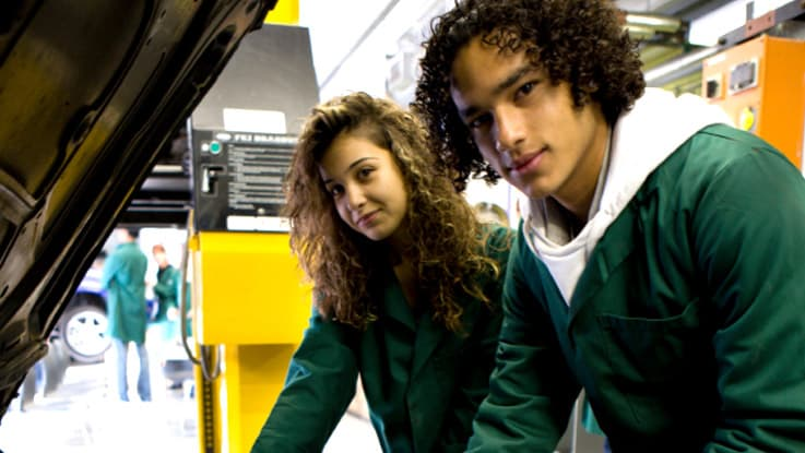 Two students doing work experience at a mechanic