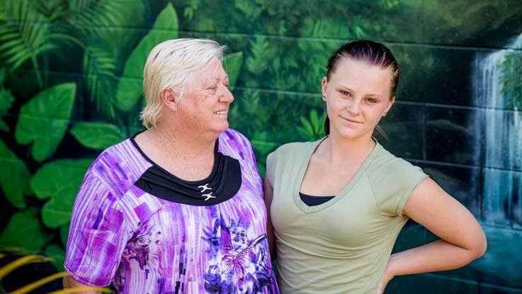 Crystal standing with her mum
