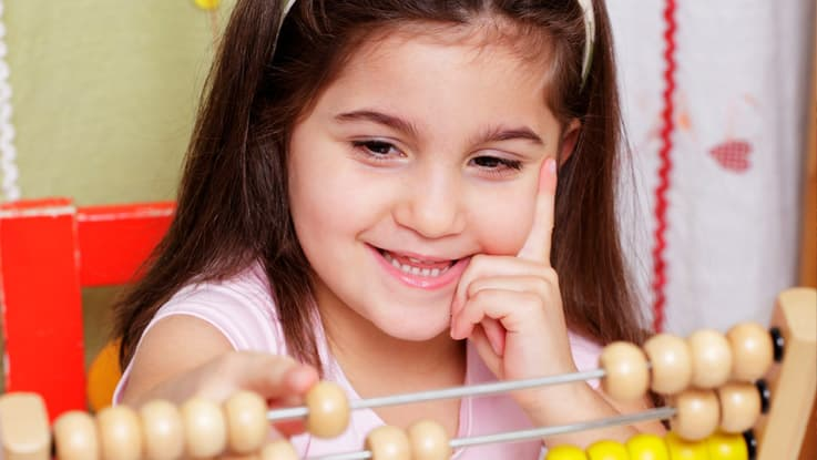 Girl learning to count using the abacus