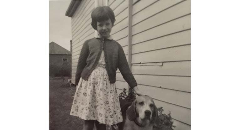iTreack Volunteer Jan as a child with dog Soda